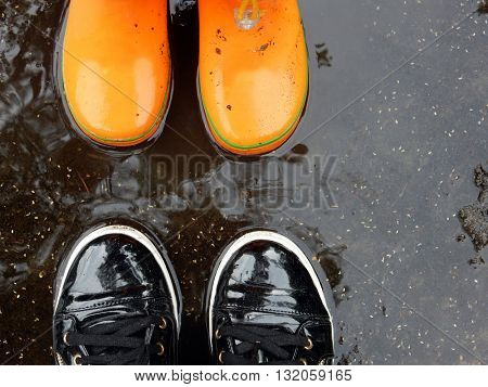 pair of shoes in a puddle