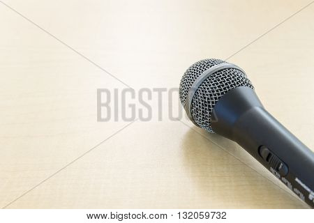 the microphone on the wooden table at the stage of seminar
