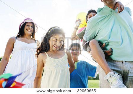 Family Outdoors Walking Toward The Camera Concept