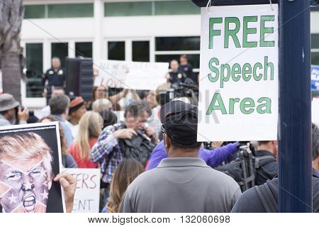 SAN DIEGO USA - MAY 27 2016: A sign marks the designated free speech area at a protest outside a Trump rally held at the San Diego Convention Center.