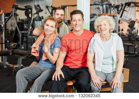 Group and senior woman after workout at the gym