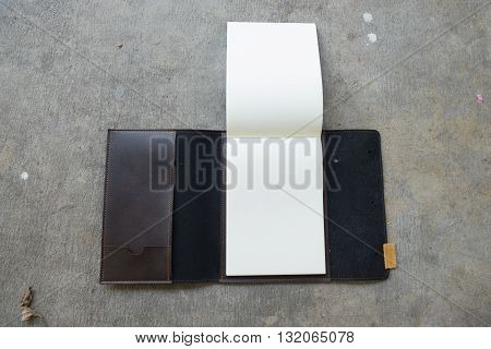 New brown leather notebook on stone background
