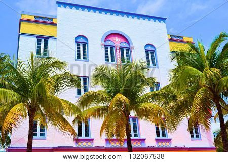 Colorful art deco style building surrounded with Palm Trees taken in Miami Beach, FL