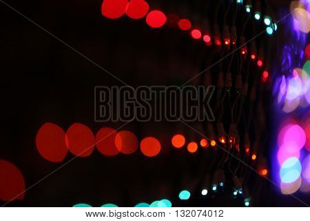 A wire mesh of colorful lights lit for decoration during a festival.