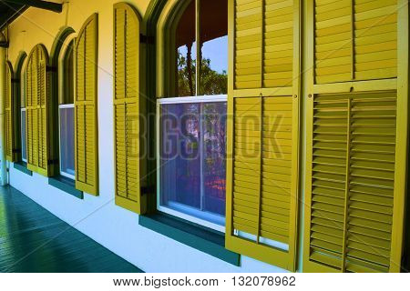 Rustic window shutters taken on a refurbished older home