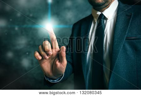 Businessman pushing virtual screen interface button concept of modern futuristic technology in service of business and entrepreneurship.