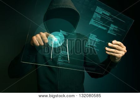Hooded computer hacker hacking biometric security internet system fingerprint identification app on futuristic tablet computer device