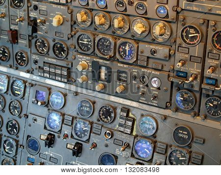 Jet aircraft cockpit Equipment with various indicators buttons dials and instruments.