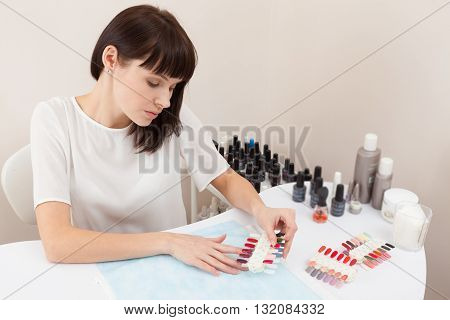Young woman at the spa nail beauty salon