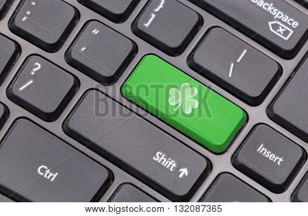 Computer Keyboard Closeup With Clover Leaf On Green Enter Key