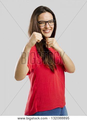 Lovely woman pretending that she's fighting