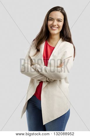 Lovely woman smiling at the camera with her arms folded