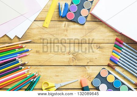 School items make a frame on wooden background with a space for your text