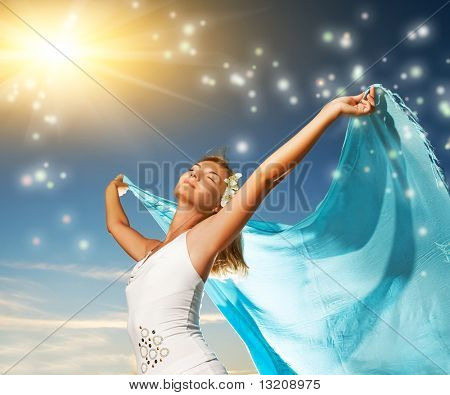 Beautiful young woman with a shawl relaxing outdoors poster