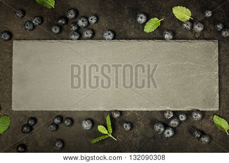 Black board and berries. Template for recipes or food menu