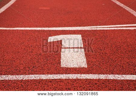 Number One. White Track Number On Red Rubber Racetrack, Texture Of Running Racetracks In Stadium
