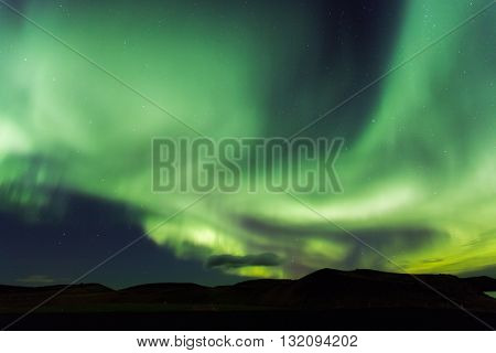 Aurora borealis. Northern lights in Iceland Myvatn. Stars in night sky illuminated by northern lights
