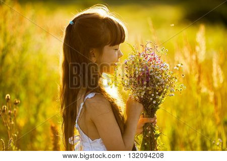 Happy girl with a bouquet of yellow flowers