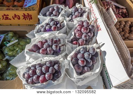 Tokyo Tsukiji Japan -November 21 2015 - Many grapes sale in front of store at Tsukiji market is a large market for fish fruits and vegetables in Tokyo Japan. which is the biggest wholesale fish market in the world.