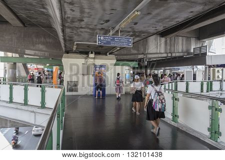 BANGKOK THAILAND - APR 29 : Unidentified people on skywalk link to BTS asoke station on april 29 2016 thailand. BTS is large Mass Transit in Bangkok
