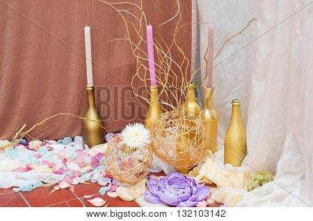 decor of candles and flowers at the wedding table in a restaurant.