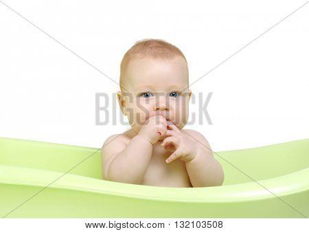 Cute baby having bath in the tub