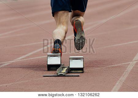 start of sprint athlete men. rear view only legs