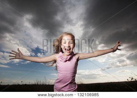 Happy smiling child at summer. Cumulonimbus