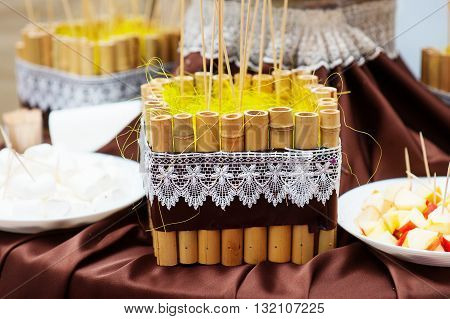 decoration of bamboo sticks on a festive table in the rustic style.