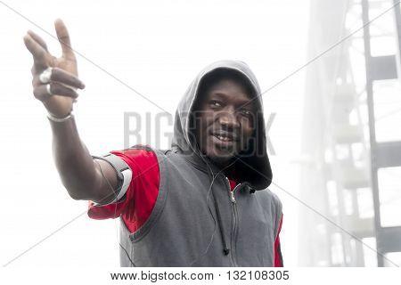 african american gang member pretends to shoot poster