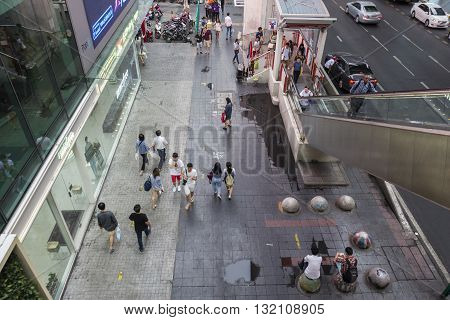 BANGKOK THAILAND - APR 30 : scene of people on walking street of Siam Square from BTS siam station on april 30 2016 thailand. siam square is famous shopping place of Bangkok