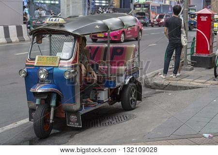 BANGKOK THAILAND - APR 30 : tuktuk parking on sidewalk of siam square on april 30 2016 thailand. tuktuk is popular taxi service of tourists in bangkok