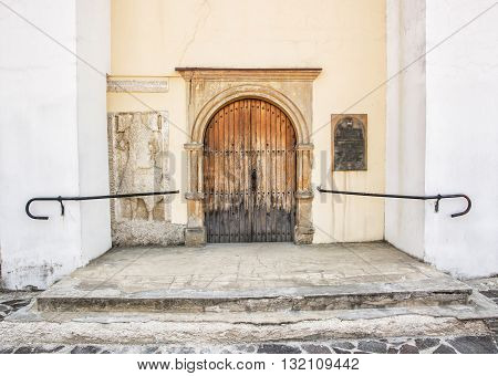 Old wooden gate with railing to the church. Trencin Slovak republic. Religious architecture. Architectural element.