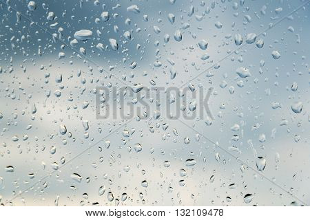a water drops on glass sky background