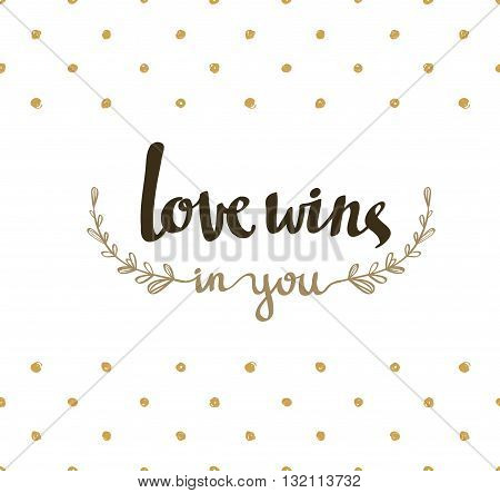 Love wins hand lettering. Modern calligraphy on the gold polka dot background
