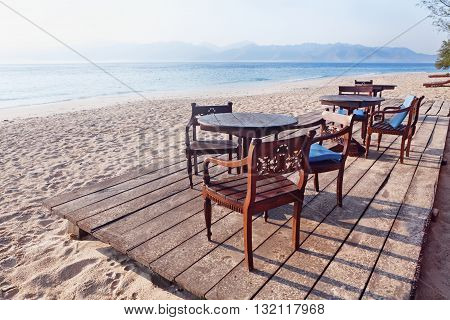 Beautiful scene on morning desert beach with white sand clear water on on tropical island Gili near Lombok. Tropic beach with no people in lost paradise. Travel vacations and relax in Indonesia.