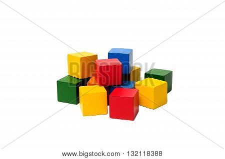 Wooden colorful building blocks isolated on white background. Cubes constructor. Vintage childrens toys.