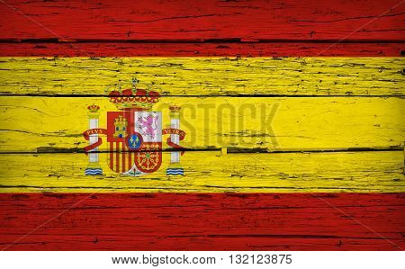 Spain grunge wood background with Spanish flag painted on aged wooden wall.