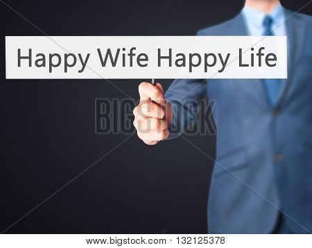Happy Wife Happy Life - Businessman Hand Holding Sign
