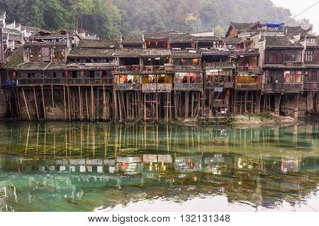 Wooden Houses Along River