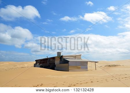 Deserted Shanty house in remote sand dunes