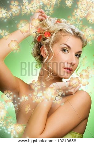 Beautiful young woman with fresh spring flowers in her hair. Spring concept.