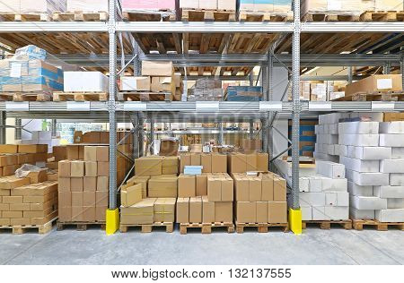 Boxes With Goods at Pallets in Warehouse Shelves