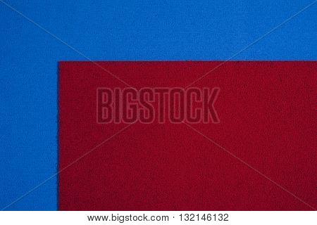 Eva foam ethylene vinyl acetate red surface on blue sponge plush background
