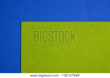 Eva foam ethylene vinyl acetate apple green surface on blue sponge plush background