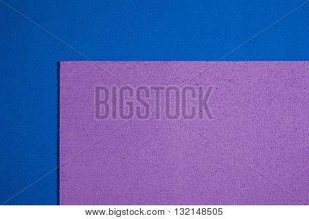 Eva foam ethylene vinyl acetate bright purple surface on blue sponge plush background