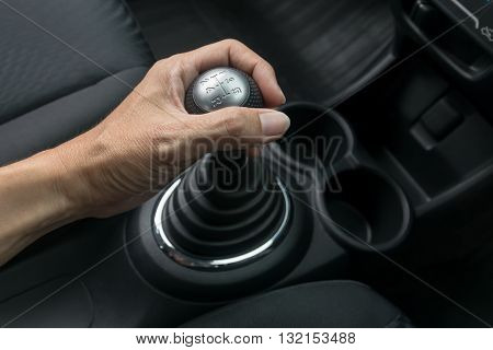 Man hand holding manual transmission. car, gear, stick, move, manual,