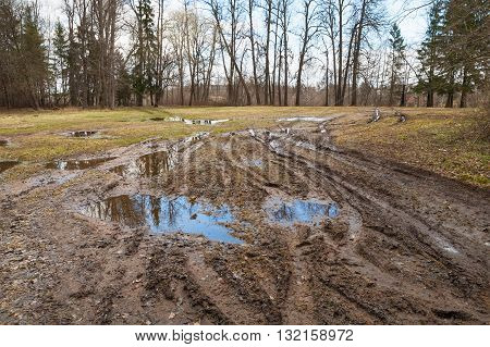 Dirty Rural Road With Puddles And Mud