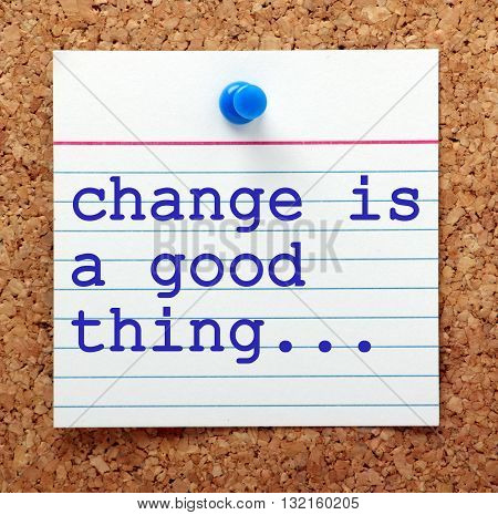 The phrase Change is a Good Thing on a note card pinned to a cork notice board as a reminder to embrace change and the opportunities it can offer