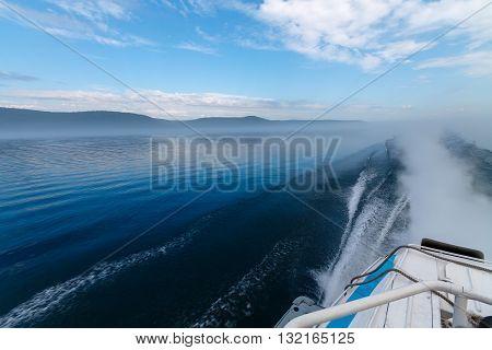 Backwash of a tourist boat on Angara river
